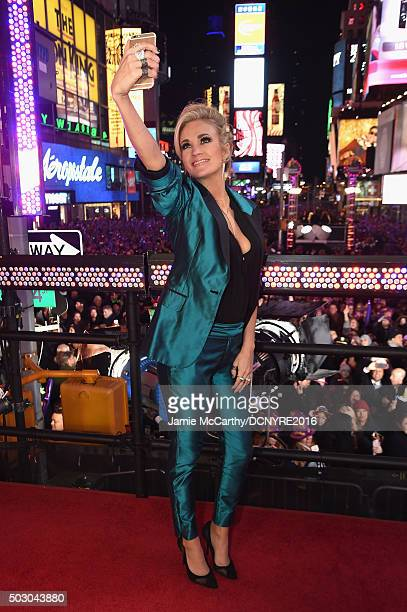 Singer Carrie Underwood poses for selfie on stage at the Dick Clark's New Year's Rockin' Eve with Ryan Seacrest 2016 on December 31 2015 in New York...