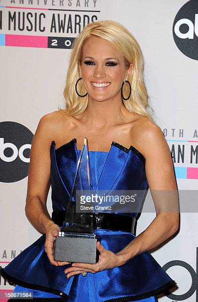 Singer Carrie Underwood poses in the press room at the 40th Anniversary American Music Awards held at Nokia Theatre L.A. Live on November 18, 2012 in...