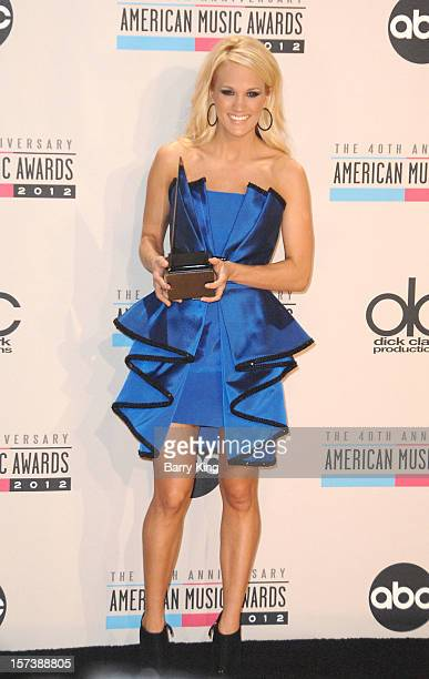 Singer Carrie Underwood poses in the press room at the 40th American Music Awards at Nokia Theatre LA Live on November 18 2012 in Los Angeles...