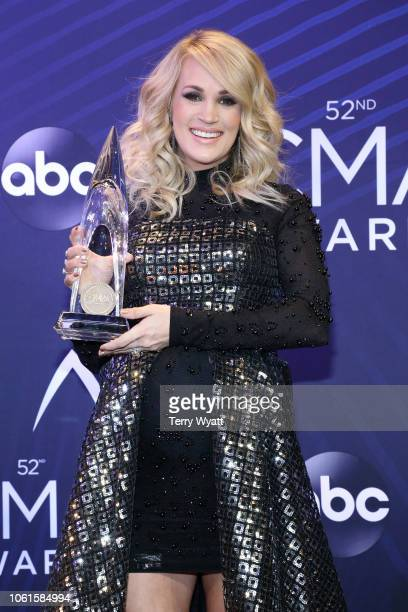 Singer Carrie Underwood poses with award during the 52nd annual CMA Awards at the Bridgestone Arena on November 14 2018 in Nashville Tennessee