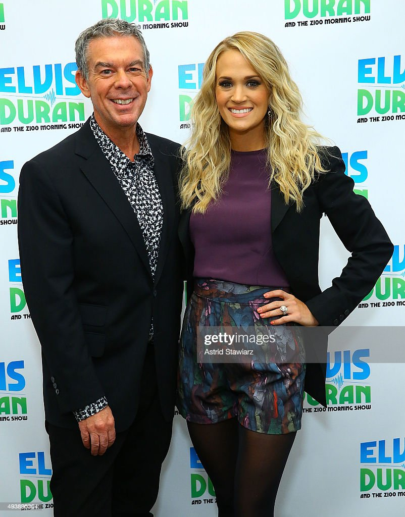 Singer Carrie Underwood poses with Elvis Duran during 'The Elvis Duran Z100 Morning Show' at Z100 Studios on October 22, 2015 in New York City.