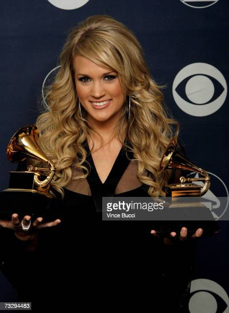 Singer Carrie Underwood poses with her Grammys Best Female Country Vocal Performance for Jesus Take The Wheel and Best New Artist in the press room...