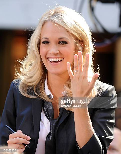 Singer Carrie Underwood shows off her wedding ring on NBC's 'Today' at Rockefeller Center on July 30 2010 in New York City