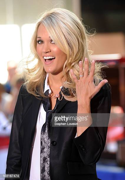 Singer Carrie Underwood shows off her wedding ring on NBC's Today at Rockefeller Center on July 30 2010 in New York City