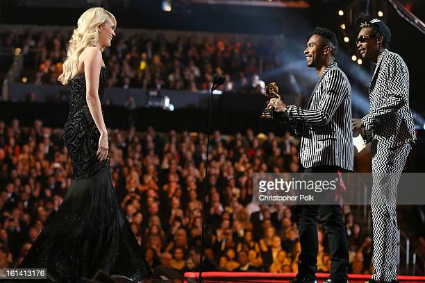 Singer Carrie Underwood singer Miguel and rapper Wiz Khalifa speak onstage during the 55th Annual GRAMMY Awards at STAPLES Center on February 10 2013...