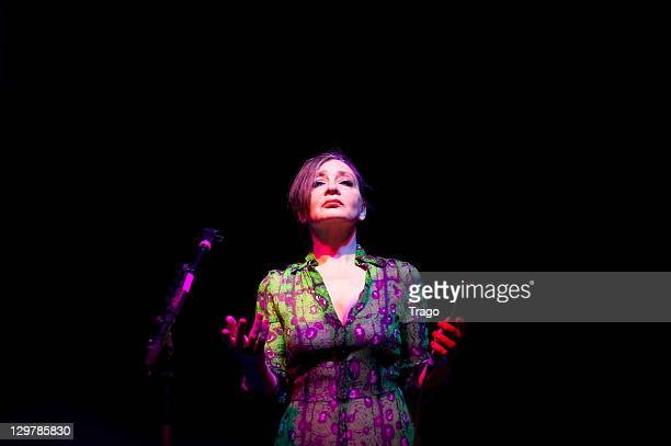 Singer Catherine Ringer performs at 'De La rue Aux Etoiles' Book Launch at JeanPaul Gaultier's on October 20 2011 in Paris France