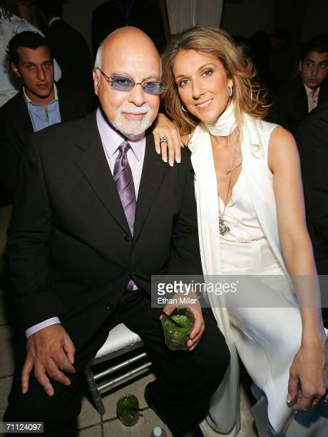 Singer Celine Dion and her husband and manager Rene Angelil pose before a fashion show by jewellery designer Chris Aire at the Pure Nightclub at...