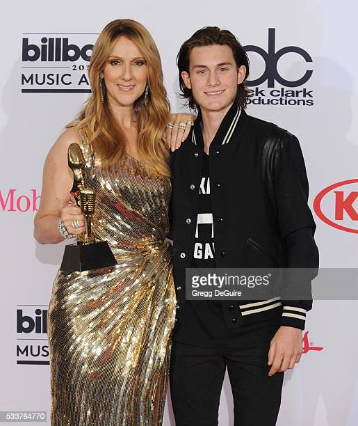 Singer Celine Dion and son Rene Charles Angelil pose in the press room at the 2016 Billboard Music Awards at TMobile Arena on May 22 2016 in Las...