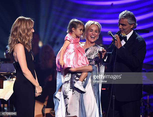 Singer Celine Dion Andrea Bocelli's daughter Virginia Bocelli actress Sharon Stone and honoree Andrea Bocelli speak onstage during the 19th annual...