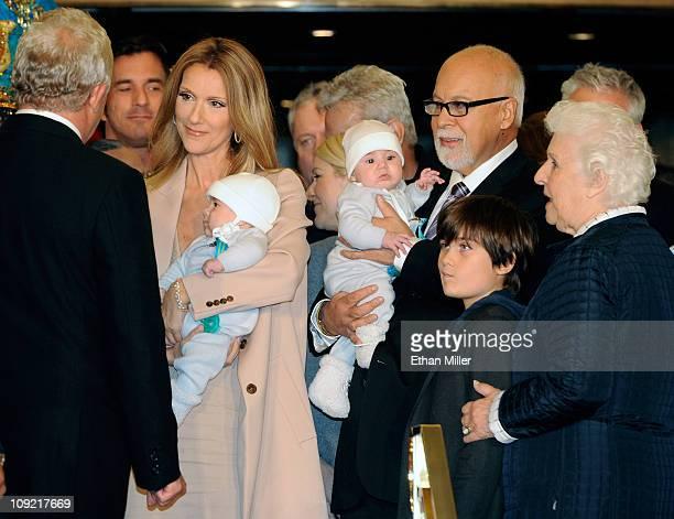Singer Celine Dion holding her son Nelson Angelil her husband and manager Rene Angelil holding their son Eddy Angelil their son ReneCharles Angelil...