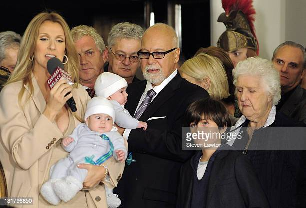 Singer Celine Dion holds her son Nelson Angelil and husband and manager Rene Angelil holds their son Eddy Angelil next to ReneCharles Angelil and...
