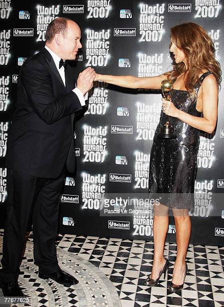 Singer Celine Dion is congratulated by Prince Albert II of Monaco after receiving her 'Legend' award at the 2007 World Music Awards held at the...