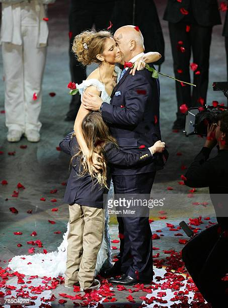 Singer Celine Dion is embraced by her husband and manager Rene Angelil and their son ReneCharles Angelil after the final performance of her show 'A...