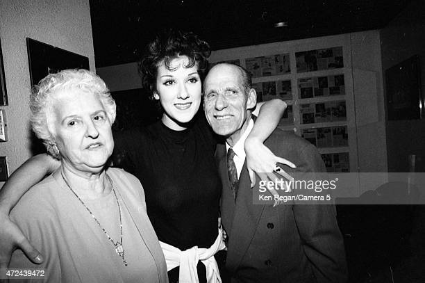 Singer Celine Dion is photographed backstage with parents in 1994 in Montreal Quebec CREDIT MUST READ Ken Regan/Camera 5 via Contour by Getty Images