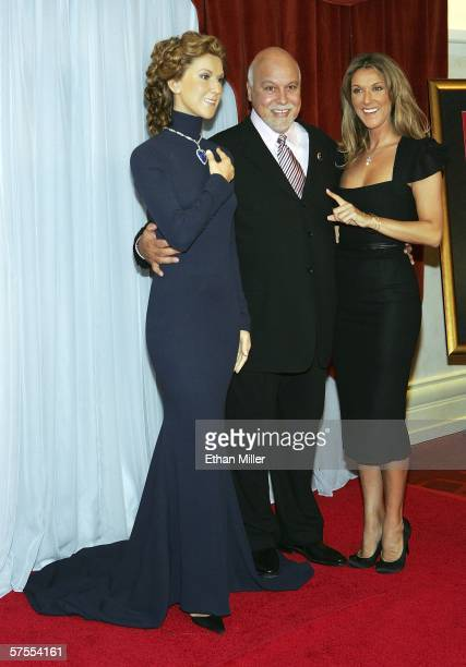 Singer Celine Dion jokes with her husband and manager Rene Angelil as they pose with a wax statue of Dion unveiled before the 500th performance of...