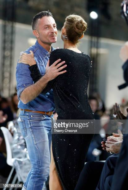 Singer Celine Dion kisses designer Alexandre Vauthier as he appears at the end of the Alexandre Vauthier Spring Summer 2019 show as part of Paris...