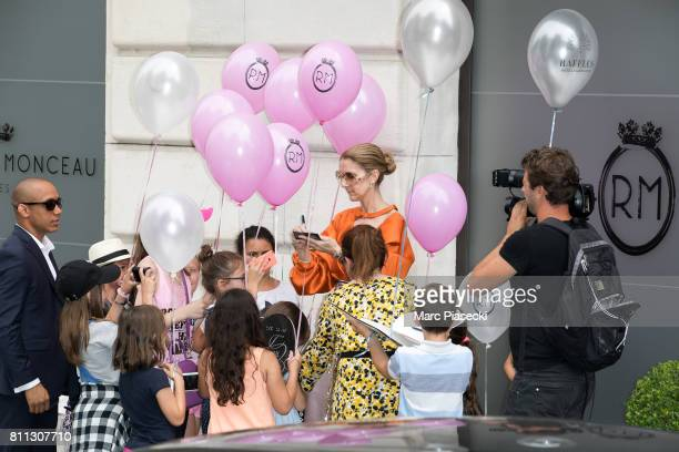 Singer Celine Dion meets young french fans outside the 'Royal Monceau' hotel on July 9 2017 in Paris France