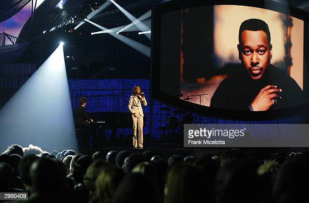 Singer Celine Dion performs Luther Vandross' Song Of The Yearnominated 'Dance With My Father' accompanied on piano by the song's cowriter Richard...