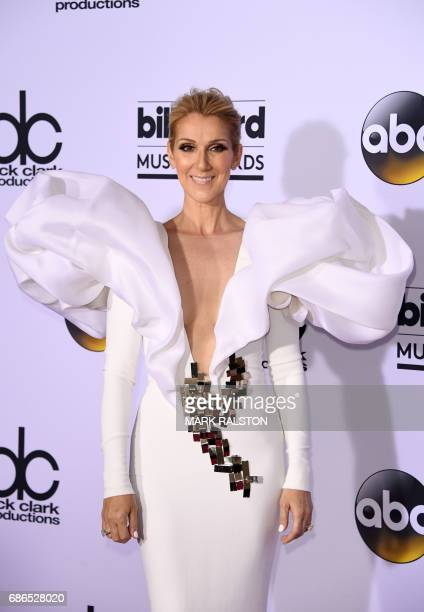 Singer Celine Dion poses in the press room during the 2017 Billboard Music Awards at the TMobile Arena on May 21 2017 in Las Vegas Nevada / AFP PHOTO...