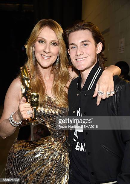 Singer Celine Dion recipient of the Billboard Icon Award and son ReneCharles Angelil attend the 2016 Billboard Music Awards at TMobile Arena on May...