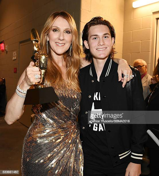 Singer Celine Dion recipient of the Billboard Icon Award and son ReneCharles Angelil attend the 2016 Billboard Music Awards at the TMobile Arena on...