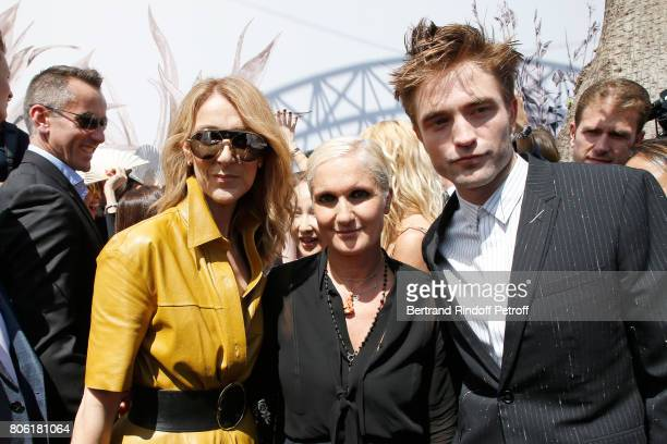 Singer Celine Dion Stylist Maria Grazia Chiuri and actor Robert Pattinson pose backstage after the Christian Dior Haute Couture Fall/Winter 20172018...