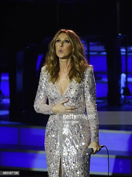 Singer Celine Dion takes a deep breath as she performs at The Colosseum at Caesars Palace as she resumes her residency on August 27 2015 in Las Vegas...