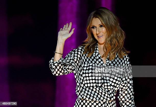 Singer Celine Dion waves during a news conference at The Colosseum at Caesars Palace before resuming her residency on August 27 2015 in Las Vegas...