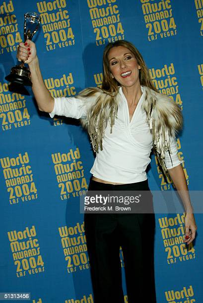 Singer Celine Dion winner of the Diamond Award poses backstage at the 2004 World Music Awards at the Thomas and Mack Center on September 15 2004 in...