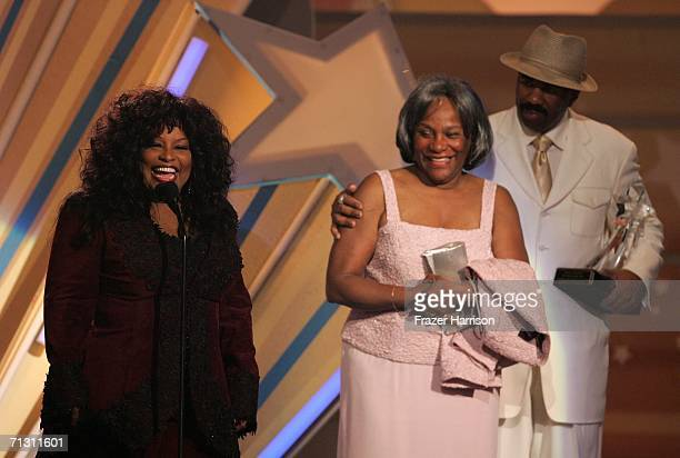 Singer Chaka Khan accepts the Lifetime Achievment Award with mother Sandra Coleman and presenter Steve Harvey looking on at the 2006 BET Awards at...