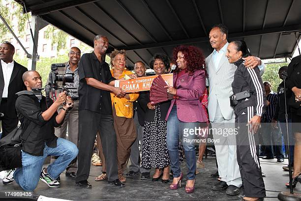Singer Chaka Khan addresses her hometown crowd after being presented the street sign Chaka Khan Way from Carl McKenzie after Blackstone Avenue at...