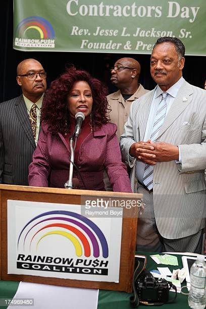 Singer Chaka Khan flanked by Reverend Jesse Jackson speaks at the Rainbow PUSH National Headquarters in Chicago Illinois on JULY 27 2013