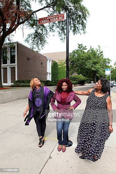 Singer Chaka Khan poses under the street sign 'Chaka Khan Way' with her sister and manager Tammy McCrary and her mother Sandra Coleman after...