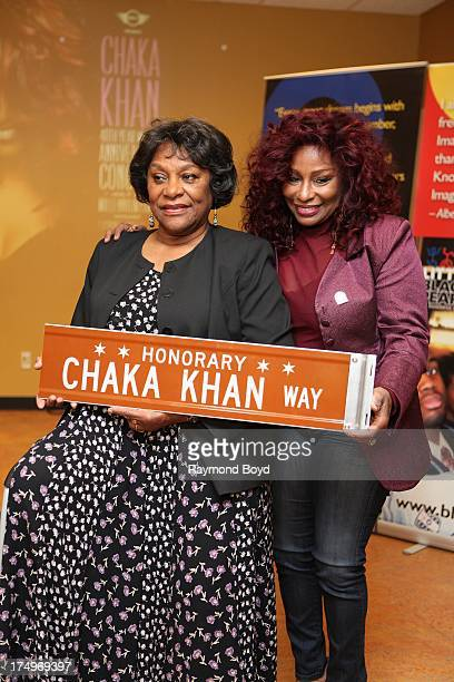 Singer Chaka Khan poses with her mother Sandra Coleman with the street sign Chaka Khan Way after it was presented to her during a street renaming...