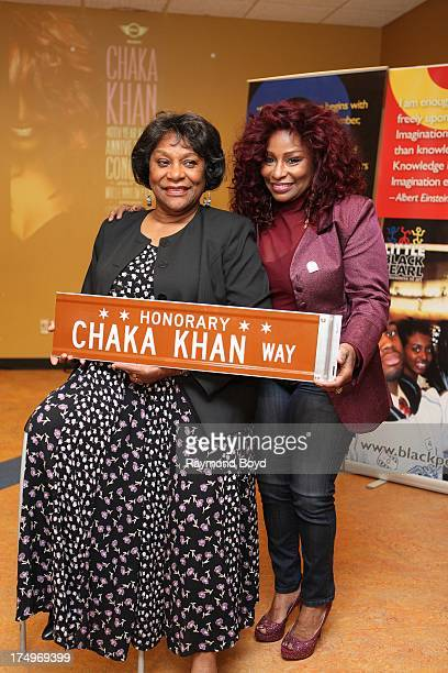 Singer Chaka Khan poses with her mother Sandra Coleman with the street sign 'Chaka Khan Way' after it was presented to her during a street renaming...