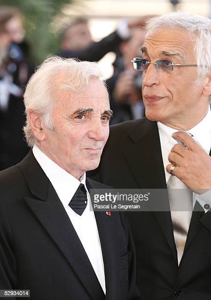 Singer Charles Aznavour and actor/singer Gerard Darmon attend the screening of Peindre Ou Faire L'Amour at the Palais during the 58th International...