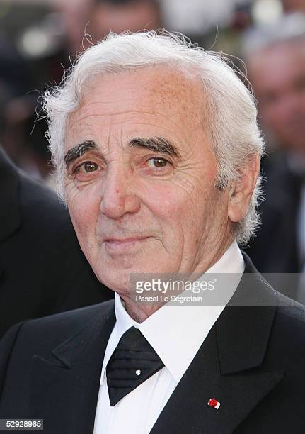 Singer Charles Aznavour attends the screening of Peindre Ou Faire L'Amour at the Palais during the 58th International Cannes Film Festival May 18...
