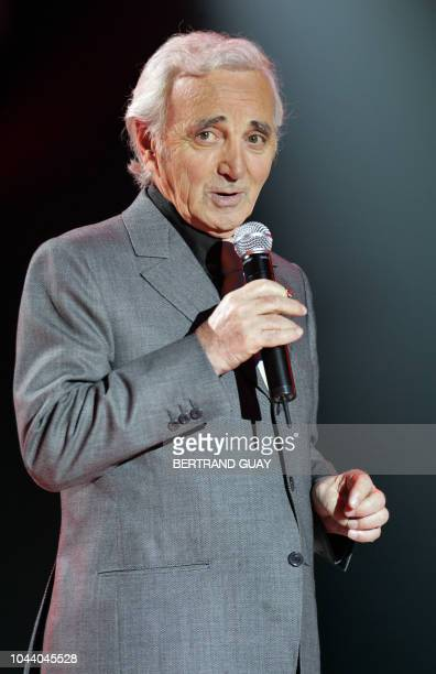 Singer Charles Aznavour performs on January 12 2005 on the set of France2 in Paris during the recording of the television program La fête de la...