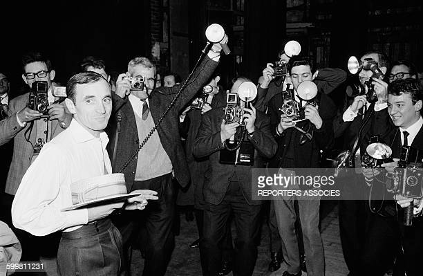 Singer Charles Aznavour with Photographers at the Olympia Music Hall in Paris France on April 3 1962