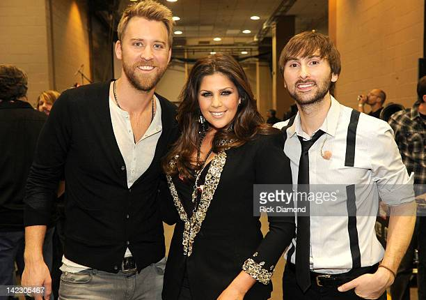 Singer Charles Kelley singer Hillary Scott and musician Dave Haywood of the band Lady Antebellum pose backstage at the 47th Annual Academy Of Country...