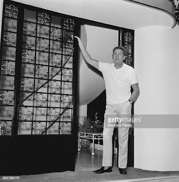 Singer Charles Trénet in his estate of the French Riviera called Boum as one of his successes on August 17, 1963 in Golfe-Juan, France.