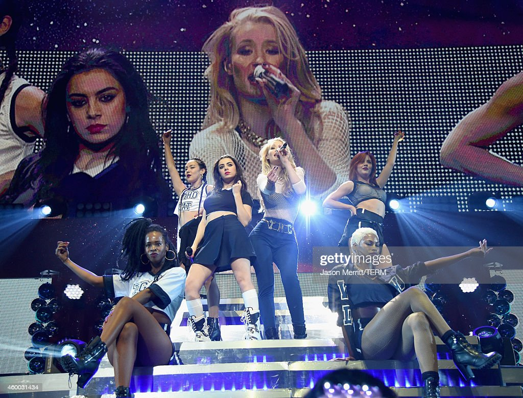 Singer Charli XCX (L) and rapper Iggy Azalea perform onstage during KIIS FM's Jingle Ball 2014 powered by LINE at Staples Center on December 5, 2014 in Los Angeles, California.