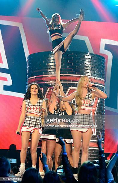 Singer Charli XCX and rapper Iggy Azalea perform with UNLV cheerleaders onstage during the 2014 Billboard Music Awards at the MGM Grand Garden Arena...