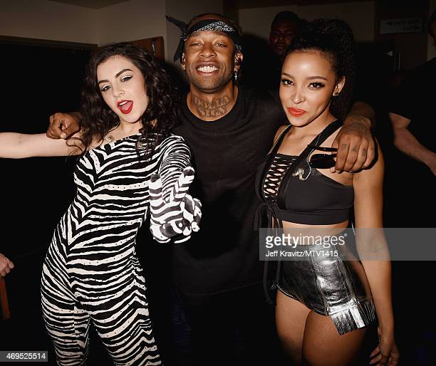 Singer Charli XCX rapper/producer Ty Dolla Sign and singer Tinashe attend The 2015 MTV Movie Awards at Nokia Theatre LA Live on April 12 2015 in Los...