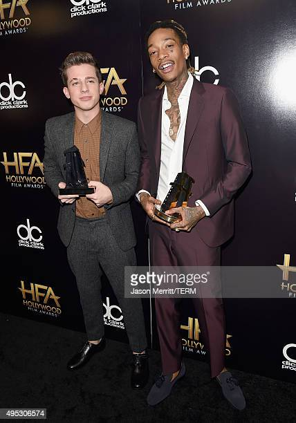 Singer Charlie Puth and rapper Wiz Khalifa pose in the press room during the 19th Annual Hollywood Film Awards at The Beverly Hilton Hotel on...