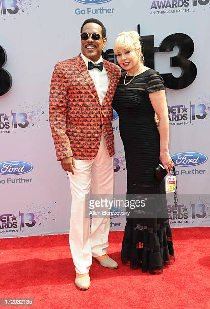 Singer Charlie Wilson and wife Mahin Tat attend 2013 BET Awards Arrivals at Nokia Plaza LA LIVE on June 30 2013 in Los Angeles California