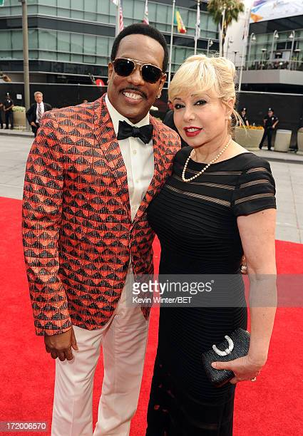 Singer Charlie Wilson and wife Mahin Tat attend the Ford Red Carpet at the 2013 BET Awards at Nokia Theatre LA Live on June 30 2013 in Los Angeles...