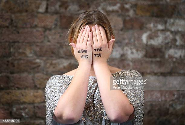 Singer Charlotte Church holds her hands to her face with 'Save The Arctic' written on them after taking part in a performance of Greenpeace's...
