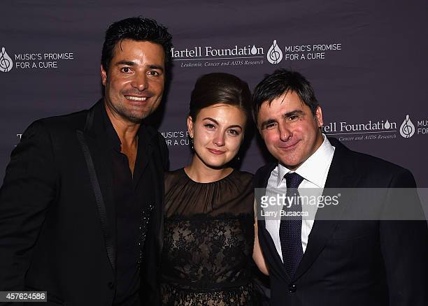 Singer Chayanne Chairman and CEO Sony Music Entertainment Latin Iberia Afo Verde and guest pose backstage at the TJ Martell Foundation's 39th Annual...