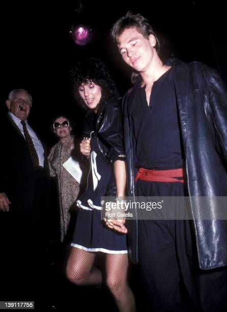 Singer Cher and actor Val Kilmer attend the 'Grease II' Premiere Party on June 9 1982 at The Red Parrot in New York City